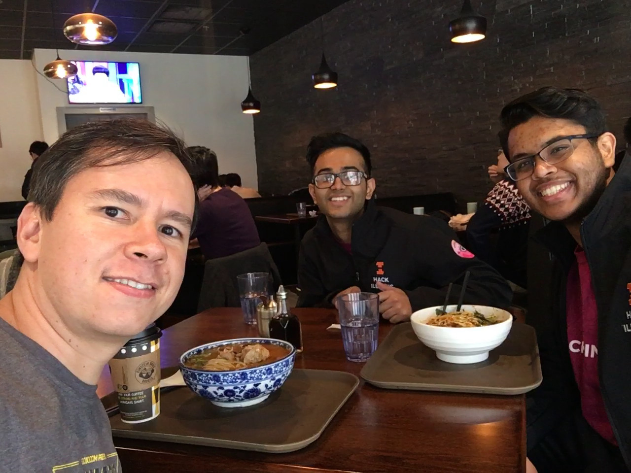 Pablo (left) has lunch with Shreyas and Kavi from HackIllinois staff (right) at Mid Summer Lounge